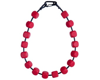 red geometric cube necklace, designer rubber jewelry handmade by Rowan Shaw for Frank Ideas