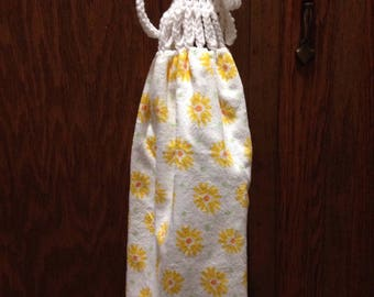 kitchen towel with a crocheted top.  White with yellow flowers towel, Pioneer Woman towel, hand towel
