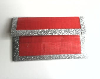 red duct tape card case with silver sparkly trim , this card case has something extra, a back pocket  for easy access to often used cards