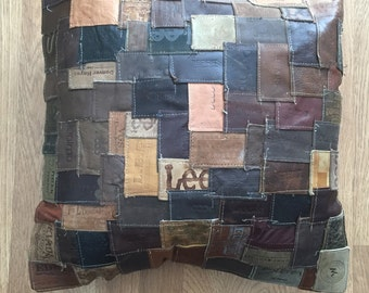 Vintage reconstructed jean tag into decorative  pillow
