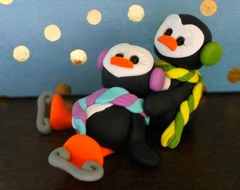 Penguin helping hand skaters polymer clay figurine