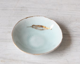 Hand built porcelain  light blue delicate bowl with gold rim and gold Narwhal whale