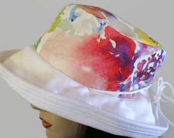 Sunblocker UV summer sun hat with large wide brim featuring colourful floral watercolour inspired print and adjustable fit