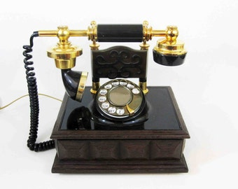 Vintage French Style Rotary Phone in Gold and Black. Circa 1970's.