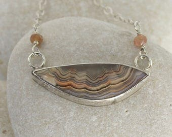 Peachy Crazy Lace Agate Necklace with cut-out silver setting