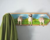 Upcycled Toy Wall Peg Rack with Sheep Hooks on Meadow Background