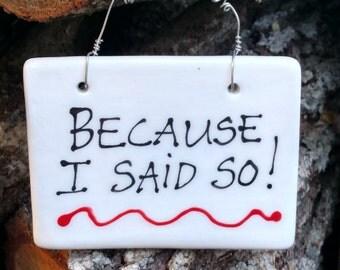 Because I said so. Hanging sign.