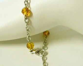 Topaz faceted glass and cross bracelet - CB05-001