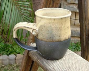 Wood fired mug with pumpkin glaze