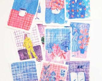 A set of 11 Blue & Purple Postcards
