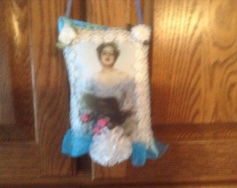 7 inch lavender scented sachet in blue with image of Victorian lady