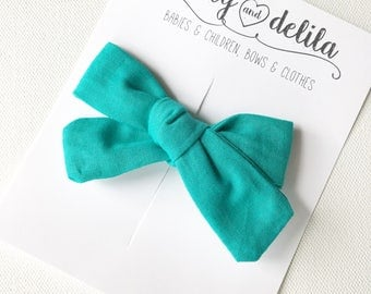 Turquoise fabric tied alligator clip bow
