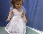 All lace doll communion dress will fit dolls such as American Girl and other 18 inch dolls