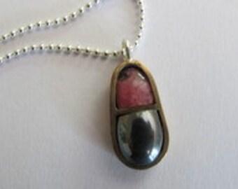 Teardrop shaped bronze pendant with hematite and pink rhodonite
