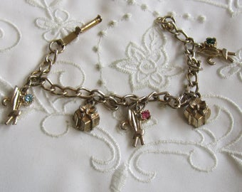 Vintage Silver Tone Charm Bracelet with Charms of Presents and Leaves with Rhinestones