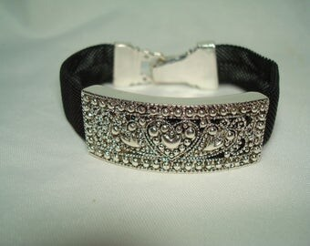 1995 Black Mesh with Silver Tone Embossed Hearts Magnetic Clasp Bracelet.