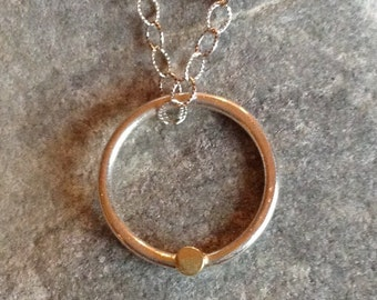 Connected. Sterling snd 18kt hold circle pendant.