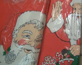 two santa paper table covers