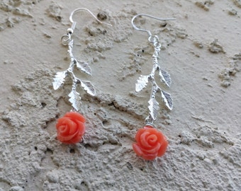 Dangling earrings feature silver leaf with coral color rosettes--FREE domestic shipping