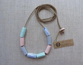 Hand Carved Tube Porcelain Necklace