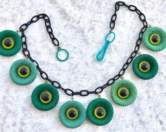 "Vintage style early plastic ""eyes"" necklace"