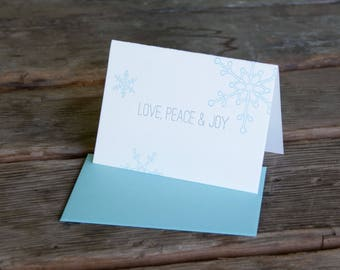 Love Peace and Joy Holiday Card, modern snowflake design in blue and grey, letterpress printed