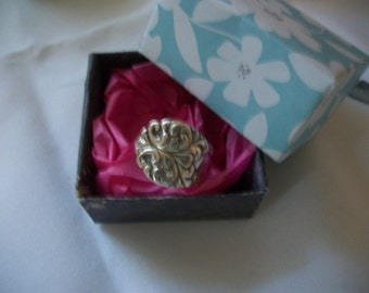A beautiful ornate ring made from antique silverware.The ring comes in a handcrafted gift box