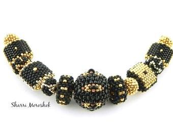 Sale - Reduced 30% -set of 13 beaded beads - by Sharri Moroshok