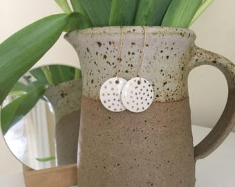 Vili, round white with golden dots porcelain earrings. Porcelain jewellery