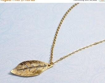 20% off. Jasmine. Gold leaf necklace. Long dangly fluttery necklace