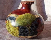 Cordovan gourd box with assorted leaves and foiled bands.  1938.