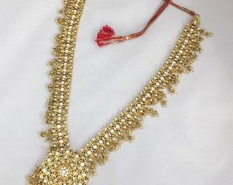 Asian gold toned metal rhinestone and beaded necklace