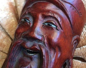 This Vintage Carved Boxwood Asian Face Has A Stone Cold Stare