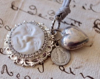 Luna: handmade silk & silver necklace. Antique porcelain moon 'feve', silver heart charm and religious medal, metal buttons