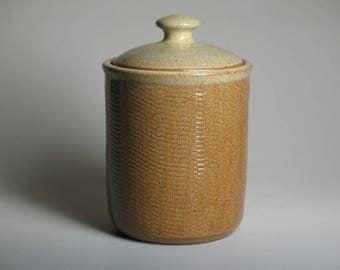 Lidded jar with gear texture