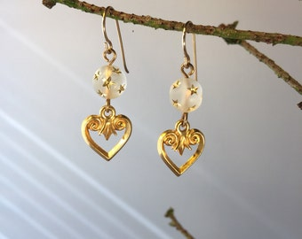 Frosted bead with gold heart