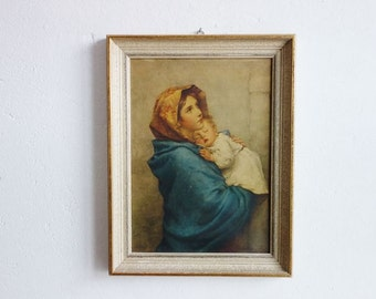 Vintage Framed Print of a Young Woman in Blue Outfit Holding a Child
