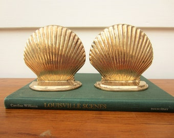 Classic brass shell bookends.  Nautical decor.  Clam shell bookends.