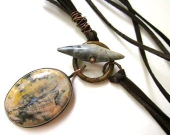 Where There's Life There's Life - primitive cream blue gray jasper, rusty link, sawdust fired ceramic toggle, faux suede metalwork necklace