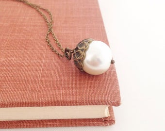 Pearl Acorn Necklace.  Glass Pearl and Antique Brass