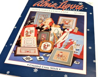 Down Santa Claus Lane Again, Vintage Alma Lynne Designs Counted Cross-Stitch Pattern Booket, Christmas Holiday Home Decor itsyourcountry