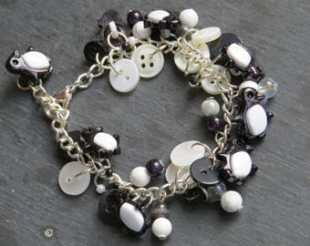 penguin black and white silver plated button and bead charm bracelet