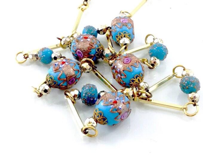 Vintage Art Deco Wedding Cake Necklace. Blue Lampwork Bead Necklace. Blue & Copper Streak Murano Venetian Glass Wedding Cake Bead Necklace.