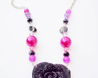 Pink, purple and black beaded pendant necklace