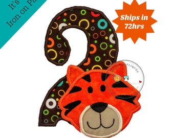 Tiger head number two birthday iron on applique in bright orange on top of modern, circle print fabric number two with matching trim