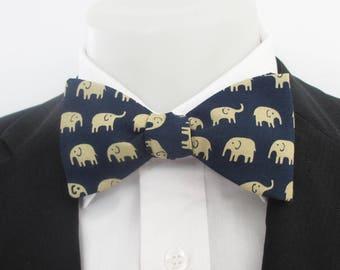 Men's bowtie ~ Marching beige elephants on a dark blue background ~ wedding bowtie~ novelty bowtie