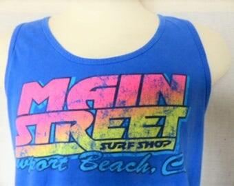 Rad vintage 80's Main Street Surf Shop Newport Beach Califonia blue tank top neon rainbow gradient pastel pink yellow logo sleeveless Large