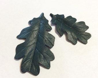 """Two 1"""" oak metallic leather leaves."""