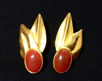 Vintage gold and faux carnelian signed Dauplaise clip earrings