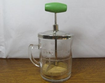 Vintage Anchor Hocking Measuring Cup with Chopper
